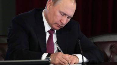 Путин повысил налог на доходы физических лиц